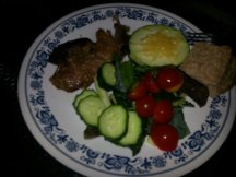 Mmmm, dinner: YUMMY pork roast, salad, grilled zucchini, and bread.